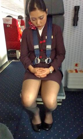 大胆な接客の外国人CAのお接待パンスト魅惑エロ画像13枚目