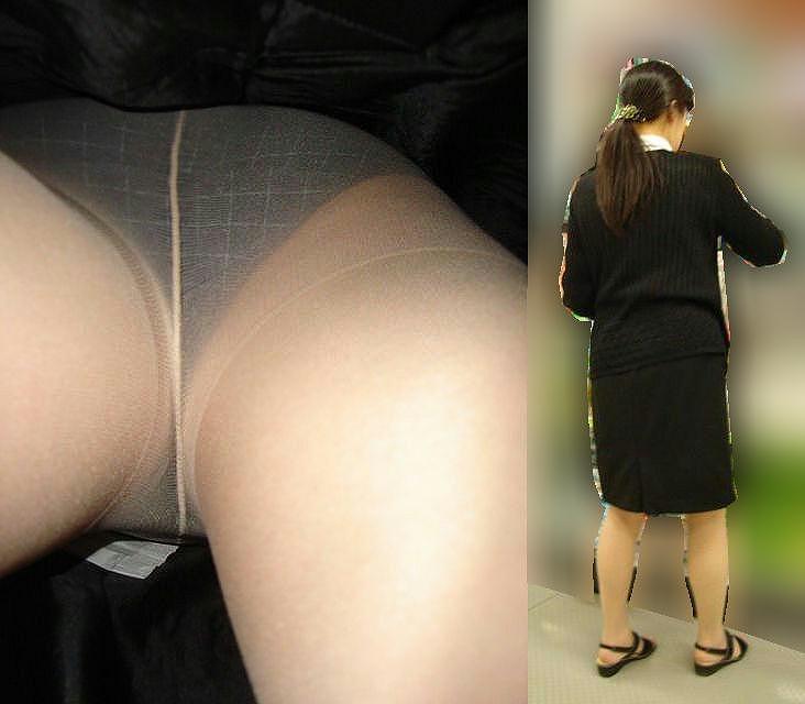 立ち読みするOLのタイトスカートを逆さ盗撮画像2枚目