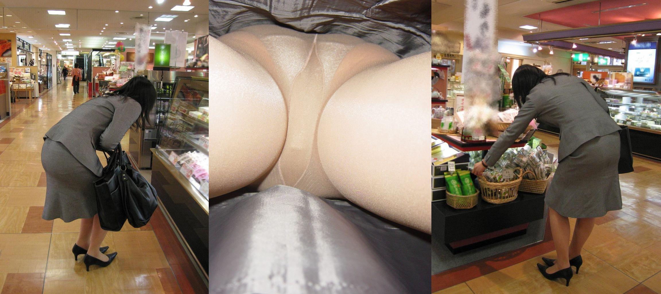 素人OLの隠しきれない巨乳と逆さパンチラ盗撮のエロ画像8枚目