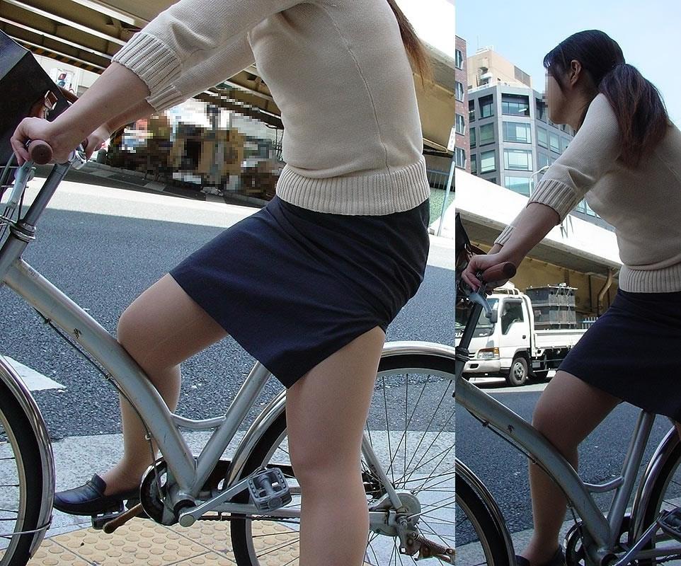 タイトスカートの自転車OLのスリット盗撮エロ画像1枚目