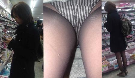 美脚OLが淫乱な網タイツを履く逆さパンチラの盗撮エロ画像7枚目
