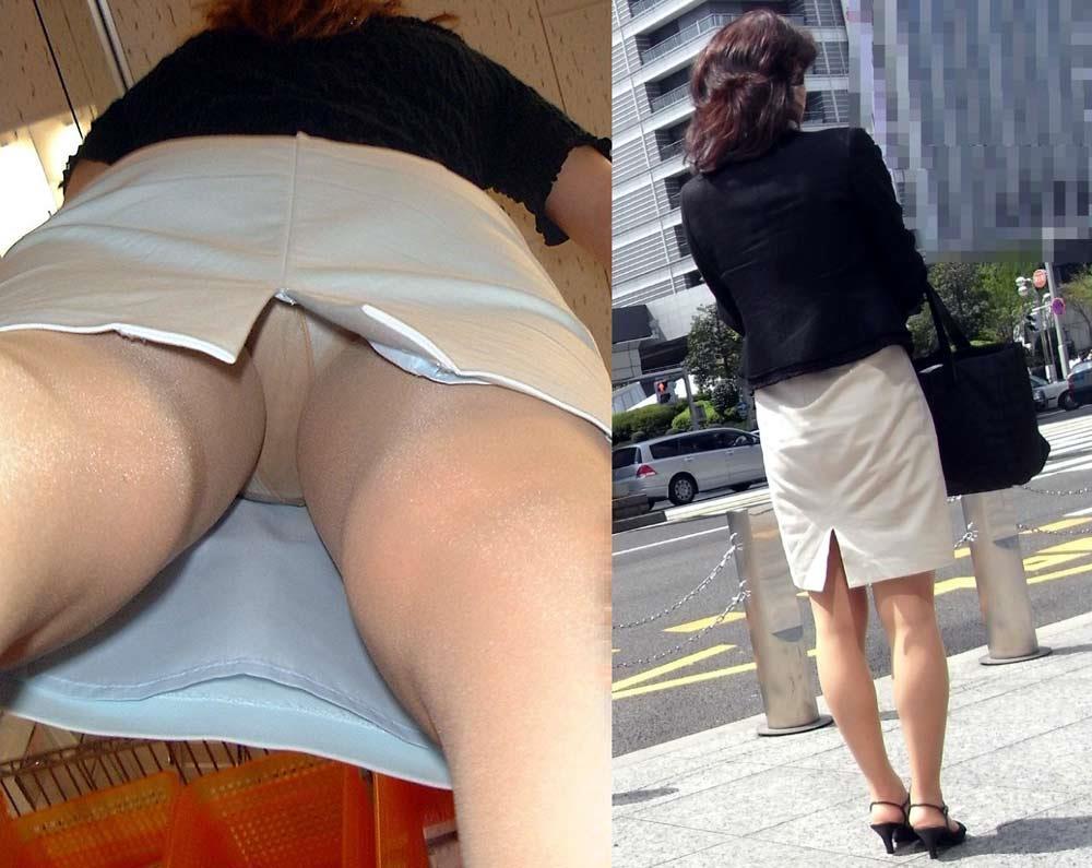街角を歩くOLのタイトスカート逆さパンチラ画像1枚目
